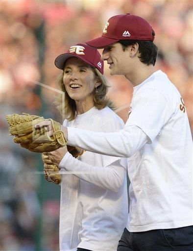 U.S. Ambassador to Japan Caroline Kennedy and her son John Schlossberg are seen smiling after Kennedy threw a ceremonial first pitch at a baseball game between Rakuten Eagles and Orix Buffaloes at Kobo Stadium Miyagi