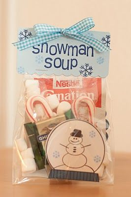 "Snowman Soup. - 1 package hot chocolate mix  - 3 Hershey Kisses - 10 mini-marshmallows - 1 candy cane Place in a small ziplock bag or in a new mug. Attach this poem: ""Was told you've been real good this year 
