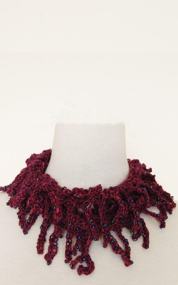Tentakler - møbius strikke i uld og med picot'er med perler