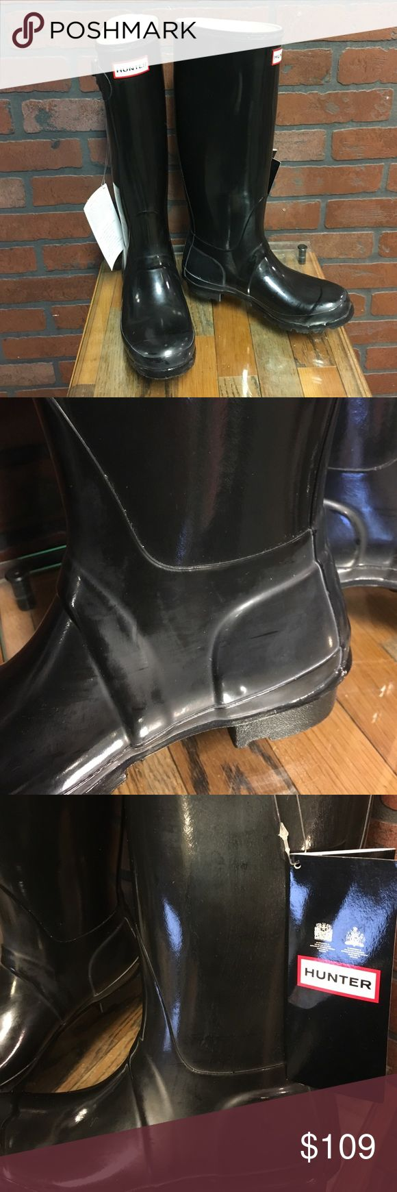 Black Hunter Boots Built for fit and comfort. Natural rubber construction. Handmade from 28 parts. Authentic original buckle. Cushioned insoles. These are brand new but scratches from display and try ons. Hunter Shoes Winter & Rain Boots