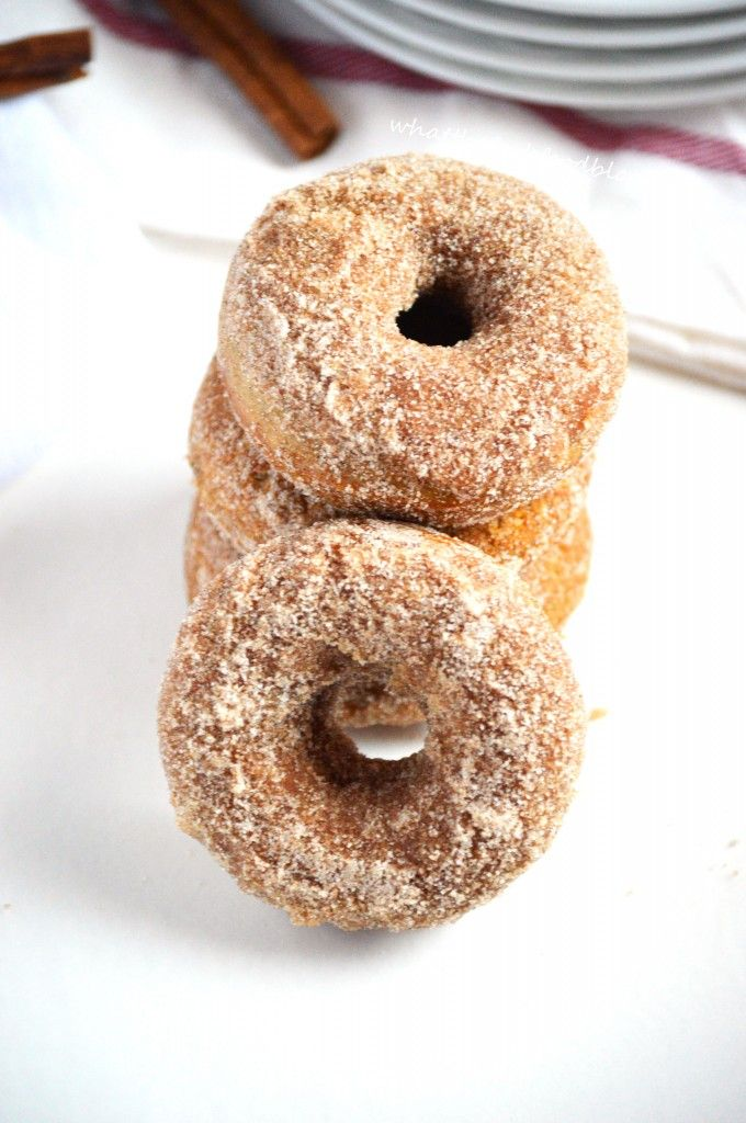 Baked apple cider donuts with a cinnamon sugar-coating.