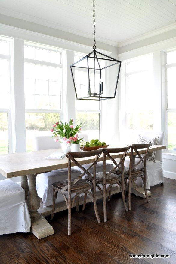 A Simple And Bright Dining Space With Lots Of White Rustic Wood Tones