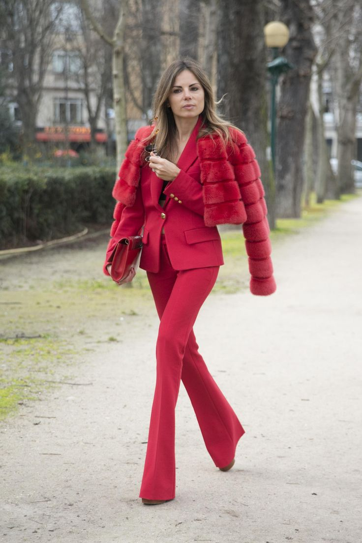 The 12 Most Popular Italian Street-Style Stars to Know - Erica Pelosini in an all red flare-leg pantsuit with matching fur coat