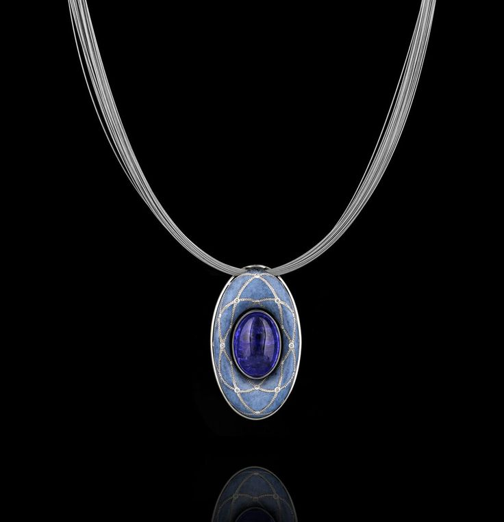 "Ever wanted to escape to a whole new world? View our celestial ""Orbit"" patinated blue bronze with pure platinum inlay and cabochon Tanzanite necklace. #CelestialHeavens #ZoltanDavid http://www.zoltandavid.com/ #ForHer ✨🌘"