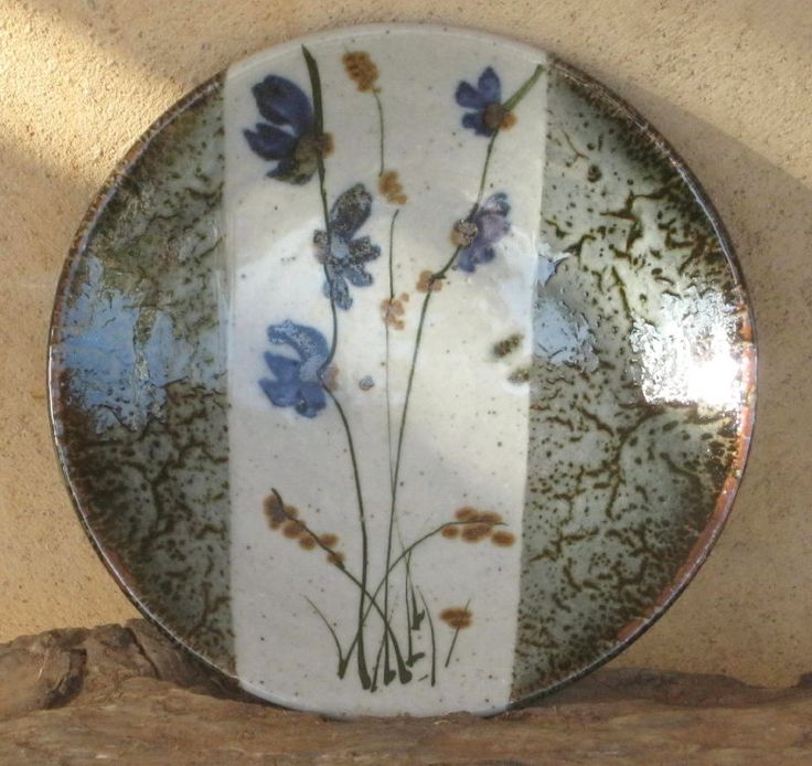 Footed plate - White glaze decorated with cobalt, iron, chrome and copper oxides.