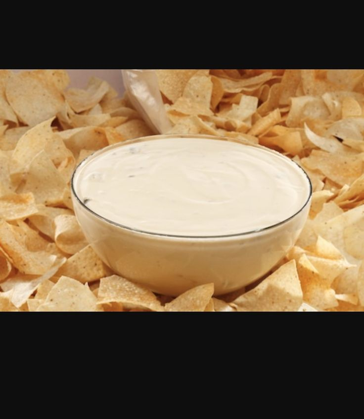 """Queso"" otherwise known as nacho cheese."