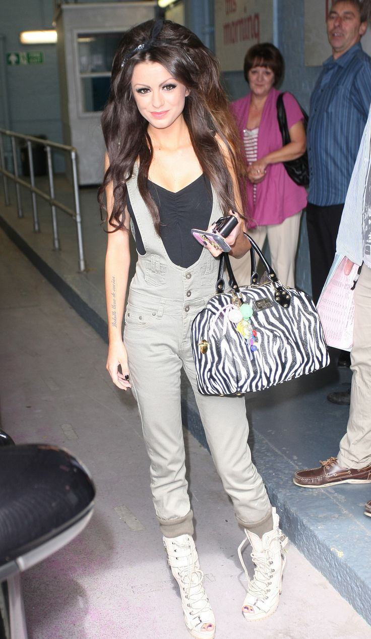 I love the hair, purse, and the outfit is okay.!!