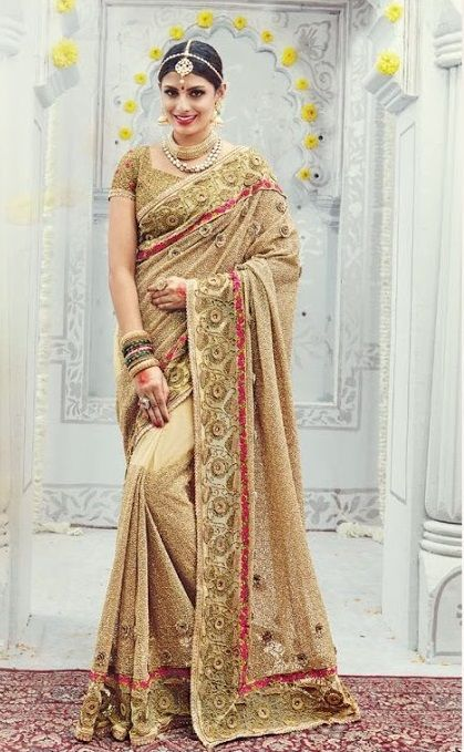 Price @9749.00 INR  Colour : Beige  Saree Fabric : Net  Blouse Fabric : Net  Work : All Over Sarees With Sequence, Thread Jari, Diamond & Moti Heavy Work Border