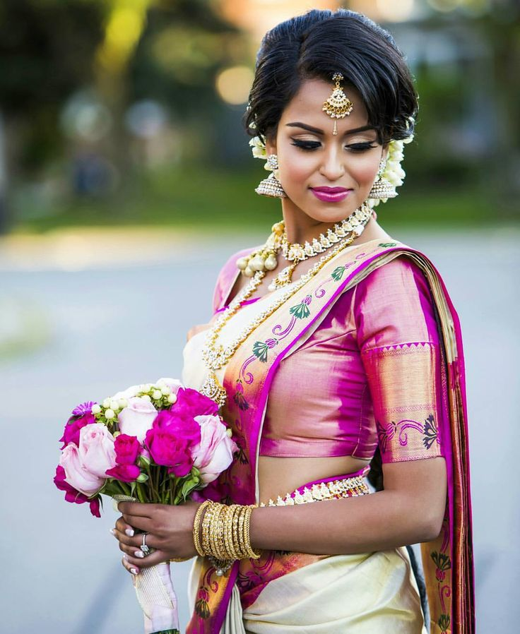 South Indian bride. Gold Indian bridal jewelry.Temple jewelry. Jhumkis. Cream white and pink silk kanchipuram sari .braid with fresh jasmine flowers. Tamil bride. Telugu bride. Kannada bride. Hindu bride. Malayalee bride.Kerala bride.South Indian wedding.