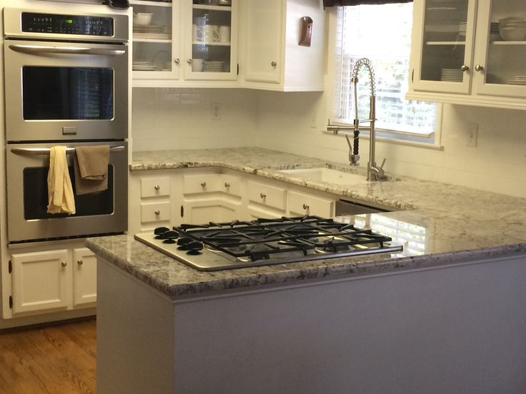 White springs granite with a white subway tile backsplash for Subway vigo