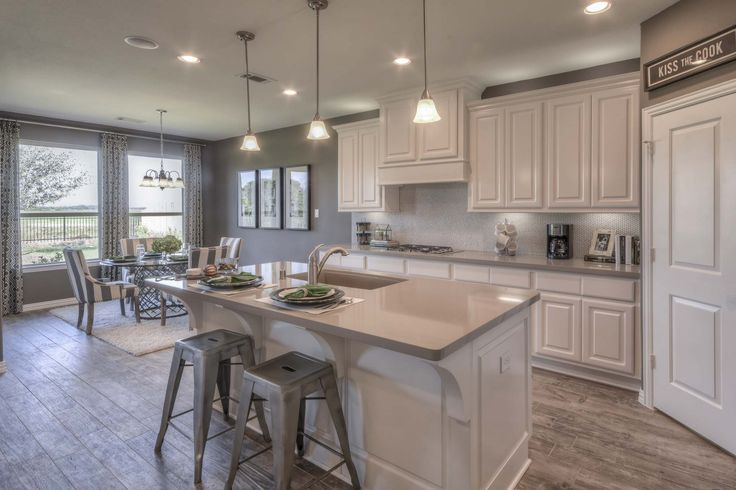 A Light And Bright Kitchen With A Penny Tile Backsplash Granite Countertops And Gorgeous Pops