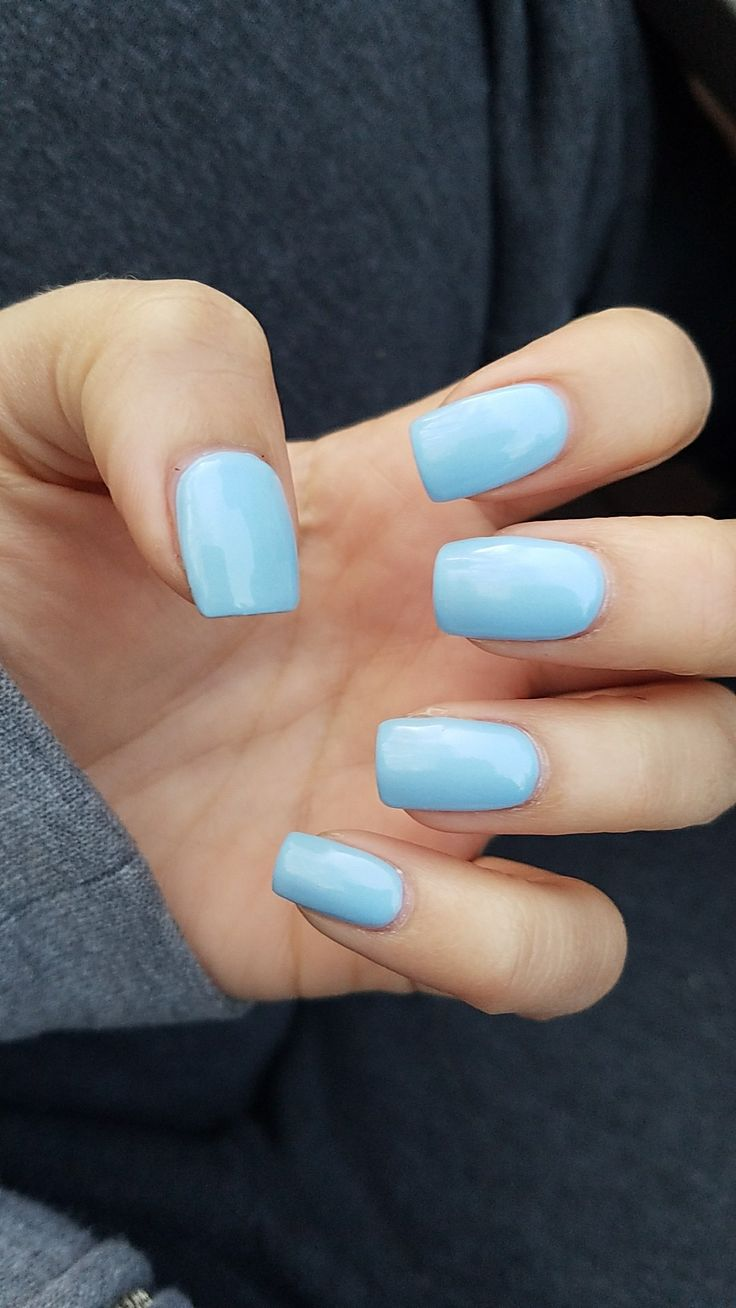 Short square light blue nails.