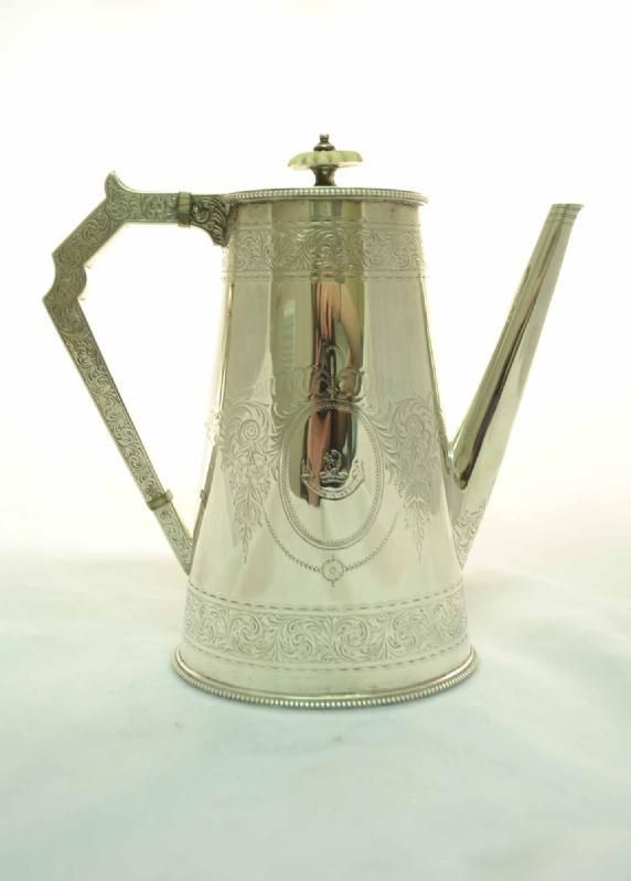 English Victorian coffee pot with hallmarks for Birmingham 1869 and the makers mark of the renowned silversmiths Elkington.