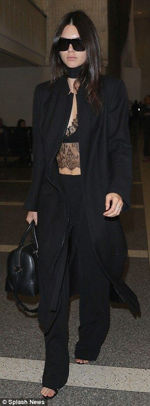 Kendall Jenner flashes midriff in sheer top as she jets off for PFW #dailymail