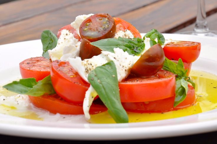 #Spring #Deliciousness at Village Melbourne...  Join us in our Village #Brasserie and #Garden for our popular Caprese Salad with Buffalo Mozzarella.  #yum #lunch #dinner #salad #red #tomato #Melbourne #wine