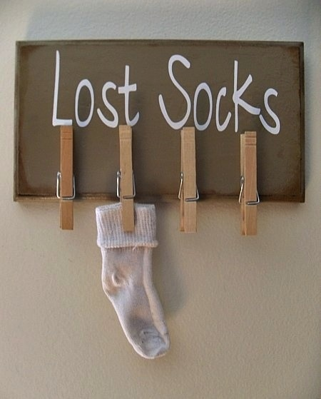 Don't leave lost socks lying around! Designate a space for them so that they can eventually be paired with their match!