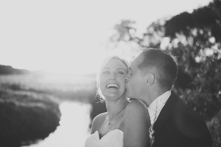 bride and groom in sunset at Sopley Mill by Kevin Belson Photography. http://kevinbelson.com  Tel: 07582 139900 or 01793 513800 or email: info@kevinbelson.com