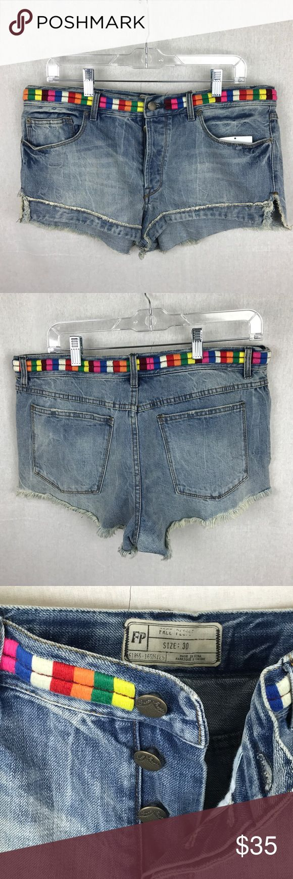 """NWOT FREE PEOPLE BUTTON FLY JEAN SHORTS SIZE 30 NWOT FREE PEOPLE BUTTON FLY JEAN SHORTS SIZE 30. COLORFUL BAND AROUND WAIST Size 17 1/2"""" inseam 2 1/4"""" overall length front 9"""" and back 11"""". These are new without tags.   Thank you for looking. Free People Shorts Jean Shorts"""