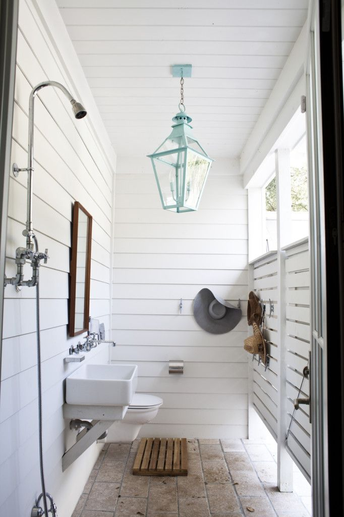 Love this outdoor shower with wall hung toilet and vanity... Easy to clean and maintain while staying functional and beautiful. *love outdoor lighting in all bath environments