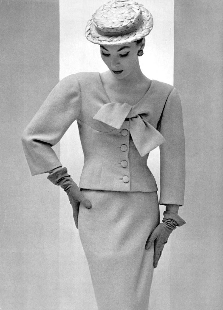 Lucky is wearing two-piece suit with the new short jacket in pastel wool by Balenciaga, photo by Pottier, 1954–i need this on my body