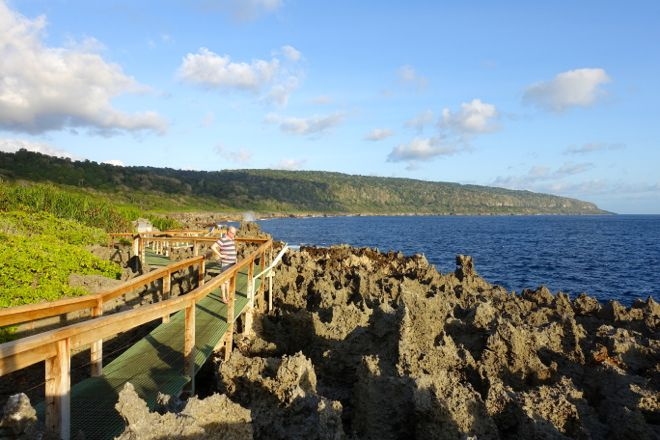 1 of 2: The walk along The Blowholes at Christmas Island. We love the contrast between the huge blue sky, deep blue ocean, verdant foliage and the exposed reef rock. Find out more at our website http://www.suitcasesandstrollers.com/articles/view/family-adventure-holidays-christmas-island-with-kids?l=all #GoogleUs #suitcasesandstrollers #travel #travelwithkids #familytravel #familytraveltips #traveltips #ChristmasIsland #outforawalk #exploring #naturalbeauty @christmasisland
