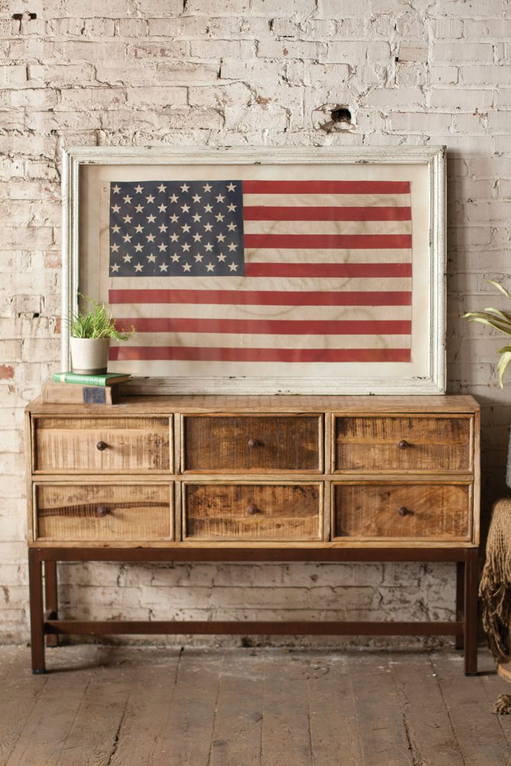 "Our Framed American Flag is a gorgeous, rustic piece of wall art that features an off-white frame that is distressed. Beautiful in any room of your home! Ships for FREE! Product Dimensions: 47.5"" x 31.5"" H"