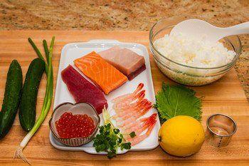 Easy and fun cucumber wrapped sushi topped with ikura (salmon roe), hamachi (yellowtail), tuna, and amaebi (sweet shrimp).
