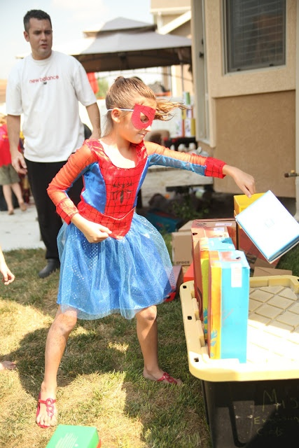 Superhero party games - punching blocks, knock over the villains, silly string, pick up poison with tongs, pin the light on iron man