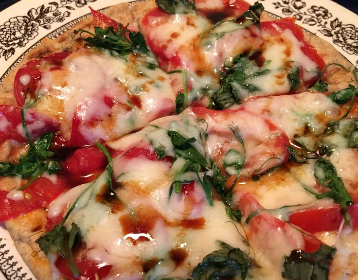 Quick and yummy supper- flatbread pizza with fresh tomatoes, basil and pea shoots, and of course YIAH Pizza Spice Blend and YIAH Caramelized Balsamic Vinegar!