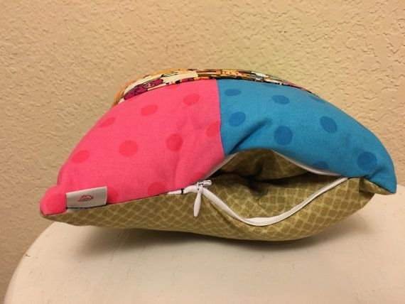 This is a secret stash pillow. It looks just like an ordinary pillow but, surprise, it has a secret pocket on the side. It can hold your phone, money ect. anything you want to hide. Its small enough to take on trips and keeps your things safe.  Its dimensions are 8X8
