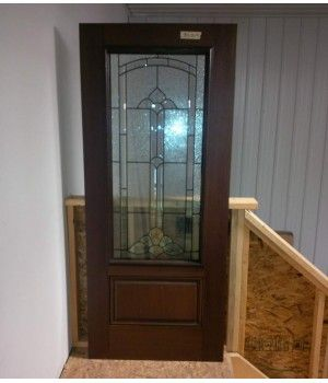 """34"""" x 79"""" Woodgrain Door Slab No Frame  This Woodgrain Fiberglass Door Slab comes with a 22x48 """"Cathedral"""" Glass Insert with Patina Caming. This Slab is also Pre-Stained!  Need a Frame Too? Call us today to price a frame for this Slab.   Can be shipped within 1 - 2 business days"""