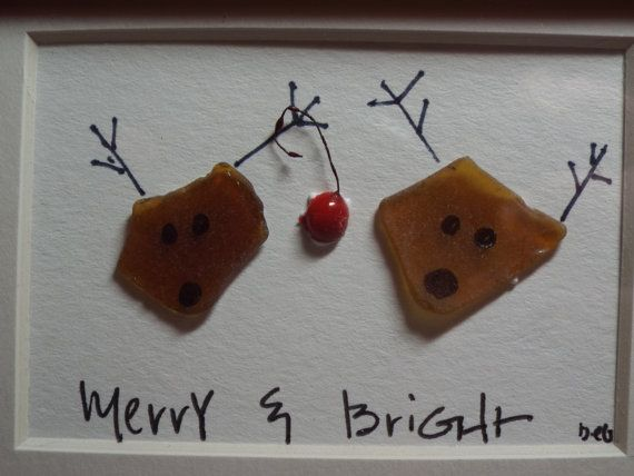 Merry and Bright are the names of two whimsical reindeer made from sea glass in an original design for Christmas. They are in a small 3 3/4 x 4 3/4 table top frame and would look great anywhere youd like a bit of whimsy in your Christmas decorations. As with all of my artwork, each piece is an original and once that piece is sold, I can create a custom duplicate - made to order and includes the matting and frame, making it a complete piece; perfect for gift giving. Each piece pictu...