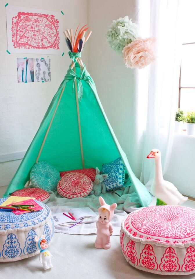 Teepee decor ideas. Love the moroccan floor pillows and cheery colors