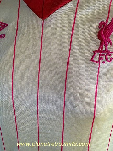 Liverpool away shirt 1982-84. Made by Umbro. This is an original Umbro shirt, not a reproduction. Liverpool were 'the side' in the early '80's. Great  Liverpool players from that era included, Neal, Hansen, Rush, Souness, McDermott & the Great Kenny Dalglish
