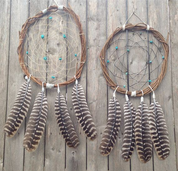 This Handmade Wood Vine Wreath + Wild Turkey Feathers Dreamcatcher is one stunning, eye-catching wall piece! Handmade with wood vine and sinew, this Dreamcatcher features beautiful turquoise stones and absolutely divine wild turkey feathers! NOTE: This Dreamcatcher is available in Black or Natural Sinew color options. Both are displayed in the first image provided. Measurements: Length (not including feathers) -approx. 10-12 Total Length - approx. 22-24 Width - approx. 10-12  Please Note…
