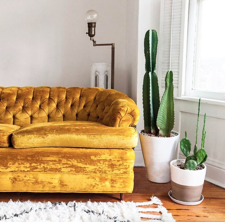 This beautiful sofa, with it's tufted back and mustard-yellow velvet, is essential for any vintage seekers home.