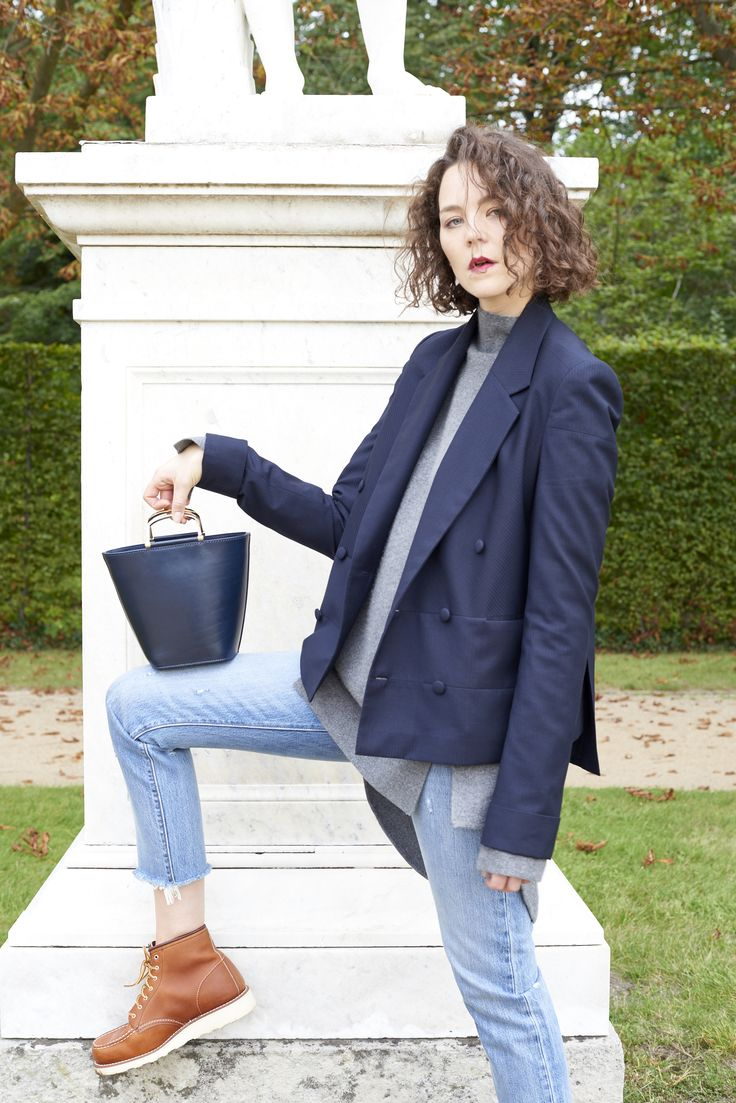 Kiki Albrecht wearing Red Wing Moc Toe Boots, Levi's Jeans, & Other Stories bag and William Fan blazer & sweater