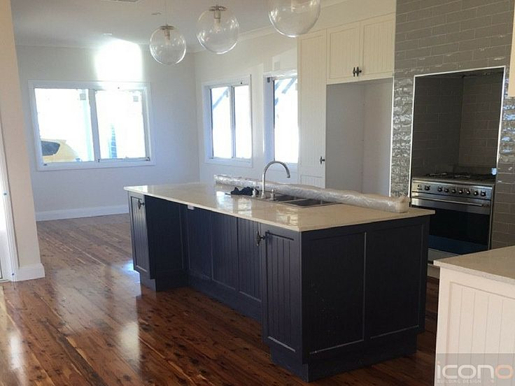 Love the dark colours in this kitchen! #islandbench #kitchen #floorboards #Australianhomes #Iconobuildingdesign