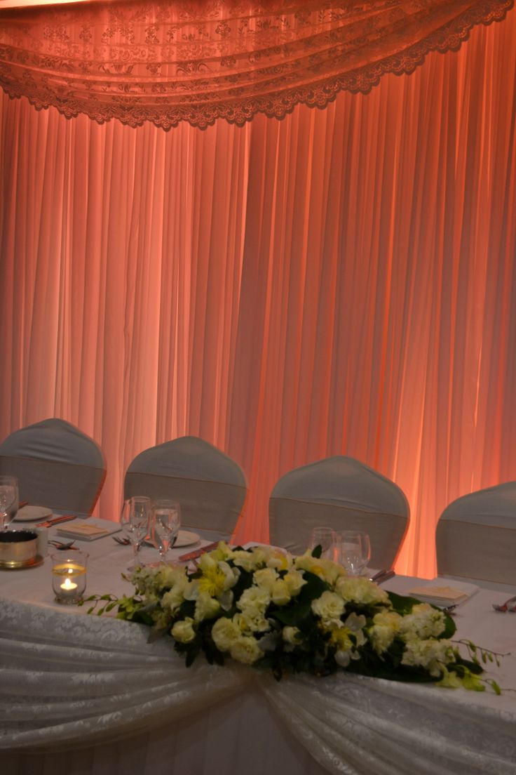 Peach lit bridal table backdrop with lace detailing. Styled by Greenstone Events.