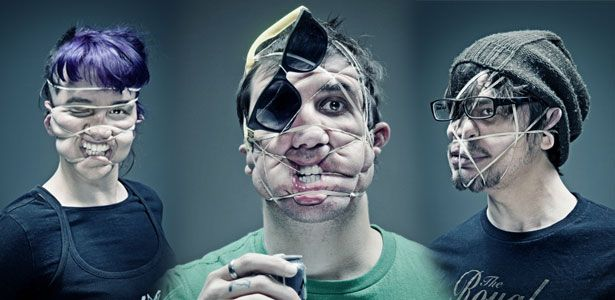Distorted portrait photography with the help of rubber bands.