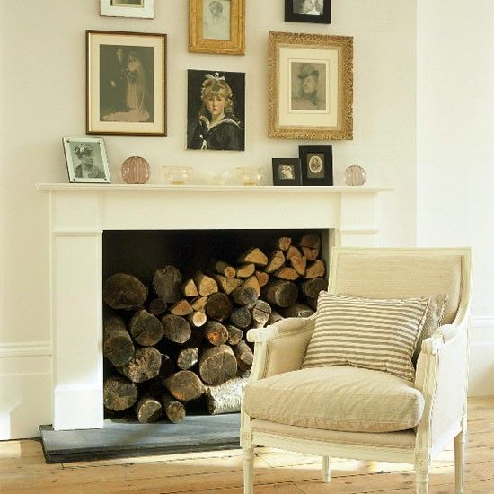 Clusters of mismatching pictures are dramatic on cream walls above the fireplace.