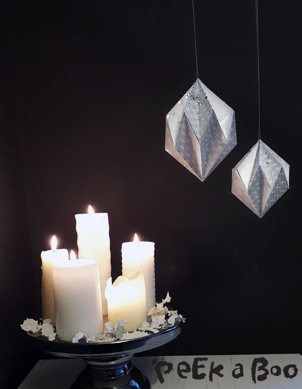 See on my blog how to fold these geometric paper ornaments. http://blog.peekaboodesign.dk/happy-new-year/