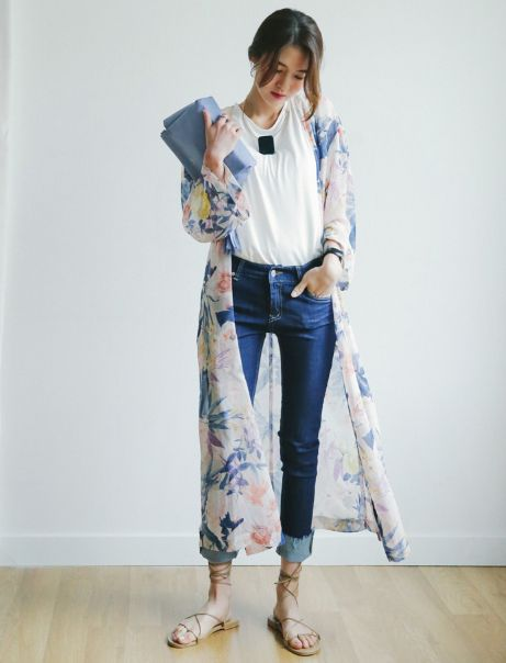This Floral Chiffon Long Cardigan features an allover floral print with an open front and long trumpet sleeves. Layer this over a plain tee tucked on skinny jeans for that simple fashionista look. - $72.00