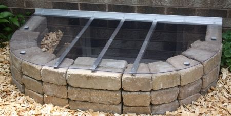 window well cover and stone edge.