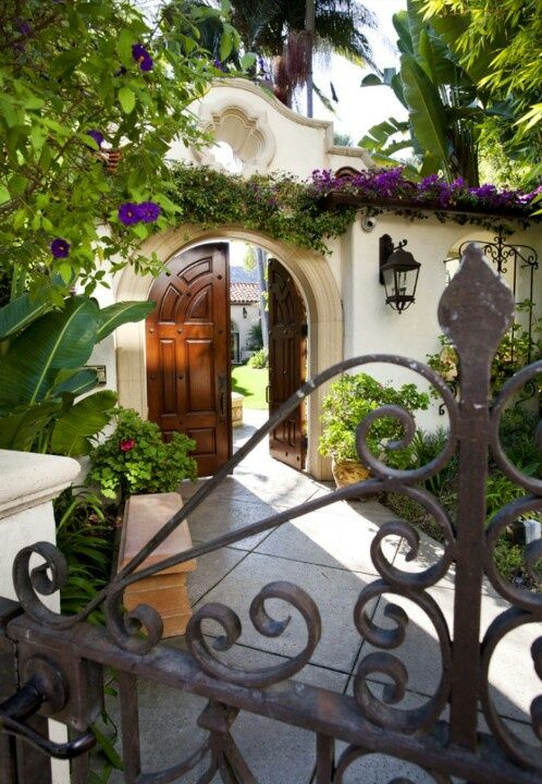 Iron Gate | Arched Wooden Doors |Courtyard entrance. ♥ #bluedivagal…