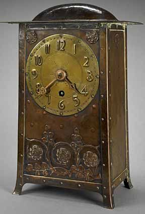 (Charles Francis Annesley) C.F.A. Voysey (1857–1941) - Mantel Clock. Copper and Brass. England. Circa 1900.