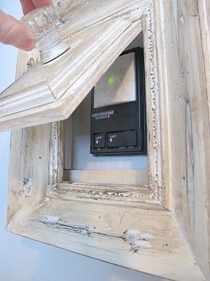 hide a thermostat, alarm keypad, etc. Cool idea!: Doors Open, Good Ideas, Hiding Things, Garage Doors, Hiding Thermostat, Cool Ideas, Great Ideas, Pictures Frames, Covers Up