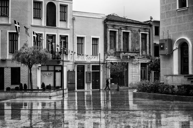 "I took this photo a day when it rained here in Rethymno using my SEL35F18 lens. An AF lens is needed when raining because I use an umbrella to take walks in the rain to shoot rainy photos. My Sony NEX-6 isn't weather proof unfortunately so if it get's wet it will go bbbzzzzztttsss and malfunction! So, one hand is busy holding the umbrella and the other one operates the camera. In this photo you can see part of the ""Platia Mitropoleos"" which in English would be ""Cathedral square"". It is ..."