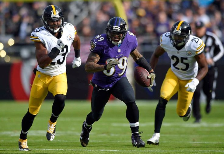 Steelers vs. Ravens:  21-14, Ravens  -  November 6, 2016  -   Baltimore Ravens wide receiver Steve Smith, center, rushes past Pittsburgh Steelers free safety Mike Mitchell, back left, and cornerback Artie  Burns in the first half of an NFL football game, Sunday, Nov. 6, 2016, in Baltimore. (Credit: AP / Nick Wass)