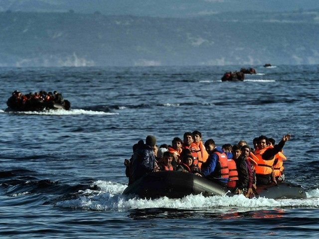 Hillary DONORz OWN NWO Her The FIX IS IN!  We NOW KNOW what The definition of IS IS !! Greek refugee boat Leros (Aris Messins / AFP / Getty)